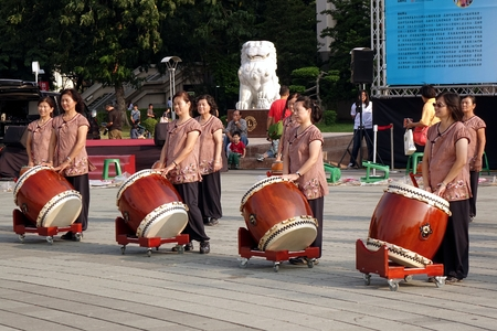chinese drum: KAOHSIUNG, TAIWAN -- NOVEMBER 8, 2014: A group of female percussionists gets ready for an outdoor performance Editorial