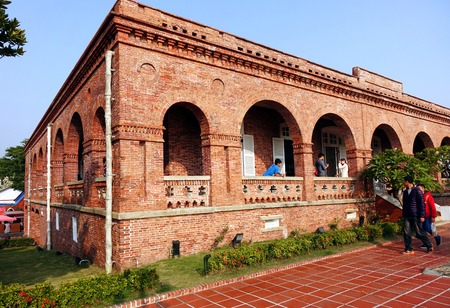 consulate: KAOHSIUNG, TAIWAN -- JANUARY 1, 2015: Tourists visit the former British Consulate, which was originally built in 1865 and has recently been restored. Editorial