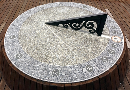 timepiece: A large sundial timepiece that is aligned with the true north Stock Photo