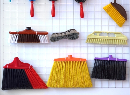 broom handle: An assortment of brooms and brushes for household and cleaning purposes Stock Photo