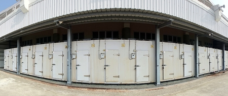 storage facility: A row of walk-in refrigerators and freezer at a commercial cold storage facility
