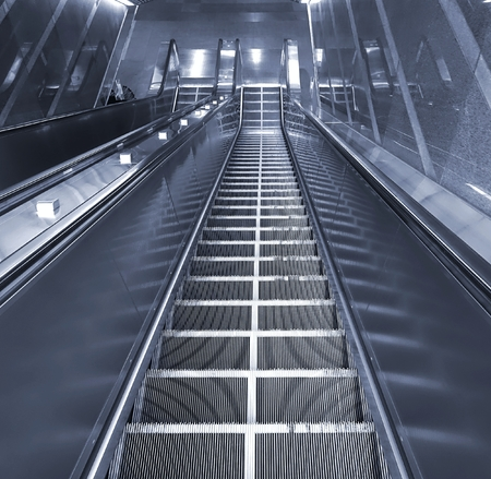 underground passage: A long escalator leading into an underground passage