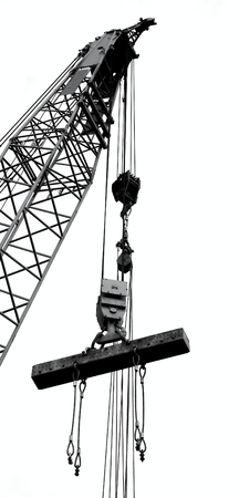 steel girder: Outline silhouette of a large crane lifting a solid steel girder Stock Photo