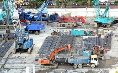 construction project: KAOHSIUNG, TAIWAN -- APRIL 18, 2015: Construction equipment and supplies are assembled for a large highrise building project. Editorial