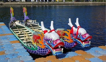 fierce competition: KAOHSIUNG, TAIWAN -- JUNE 14, 2015: Boats with the traditional dragon head sculpture design are prepared for the yearly Dragon Boat Races on the Love River. Editorial