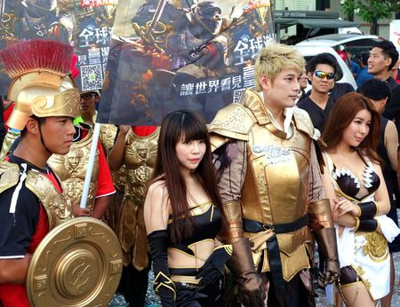 clash: KAOHSIUNG, TAIWAN -- JUNE 17, 2015: Actors dressed up in fantasy costumes promote the mobile app strategy game Clash of Kings at a public event. Editorial