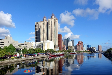 KAOHSIUNG, TAIWAN -- JUNE 17, 2015: Beautiful view of the Love River on a clear day with the lanes in the river marked out for the Dragon Boat Races.