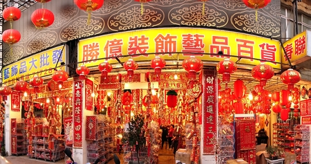 charms: KAOHSIUNG, TAIWAN -- JANUARY 22, 2015: A large store sells colorful decorations, lanterns, lucky charms, paper cuts and printed couplets and proverbs for the Chinese New Year. Editorial