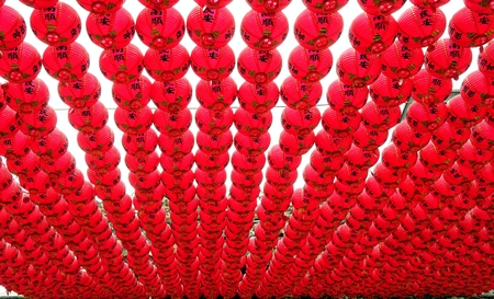 in a row: KAOHSIUNG, TAIWAN -- AUGUST 12, 2015: Multitudes of red lanterns decorate the courtyard of the Tian Hou Temple on Chijin Island.