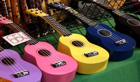 nylon string: Colorful ukuleles on sale at an outdoor stall