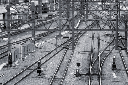railway track: Multiple train tracks, signals and high voltage power lines close to a train station