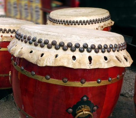 chinese drum: Large ceremonial Chinese drums with brass handles and big brass tacks Stock Photo