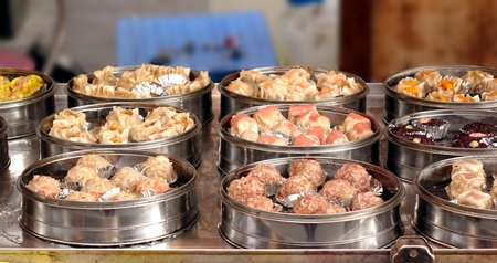cantonese: An outdoor vendor sells Cantonese Dim Sum dishes cooked in metal steamers Stock Photo