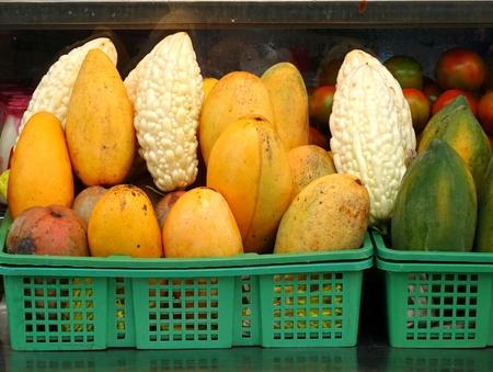 vendor: A fresh juice vendor displays bitter gourds, mangos and papayas