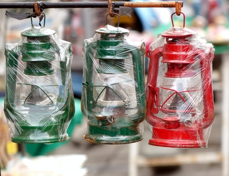 oillamp: Old style cold blast kerosene lamps in green and red