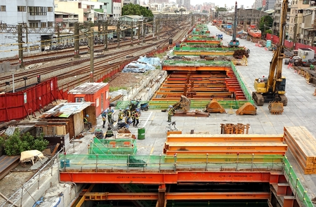 railway transport: KAOHSIUNG, TAIWAN -- AUGUST 15, 2015: Large scale construction work continues on the project to move the city rail tracks underground.