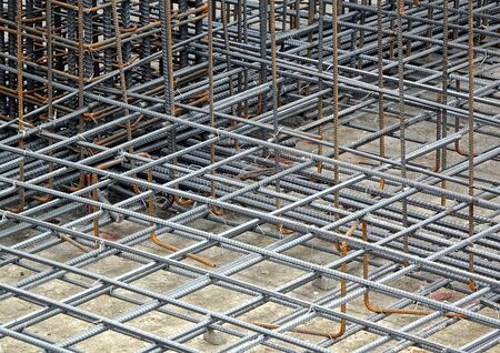 iron bars: Reinfirced steel bars are being prepared for a concrete foundation Stock Photo