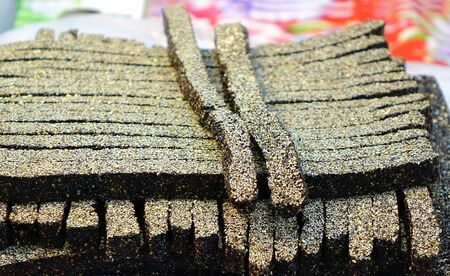ajonjoli: Long strips of Chinese black sesame candy with malt syrup Foto de archivo