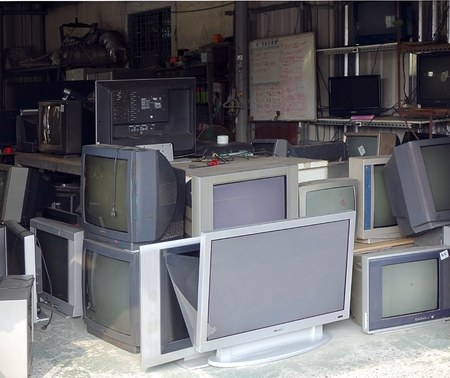 cathode: KAOHSIUNG, TAIWAN -- OCTOBER 17, 2015: A local store for the repair and recycling of traditional and flat screen televisions.