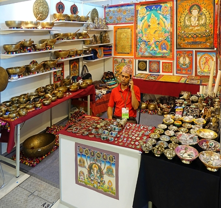 gong bowl: KAOHSIUNG, TAIWAN -- OCTOBER 8, 2015: A stall sells Tibetan religious artifacts at a local trade fair.
