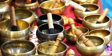 singing bowls: A collection of Tibetan singing bowls with mallets Stock Photo