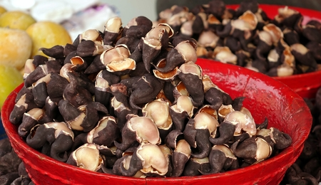 basins: An outdoor vendor sells Chinese water chestnuts in red basins