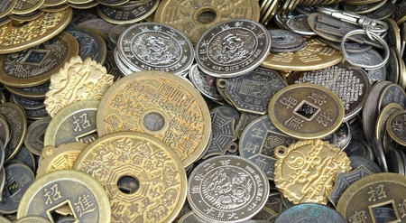 imitations: A street vendor sells imitations of old Chinese coins and currency