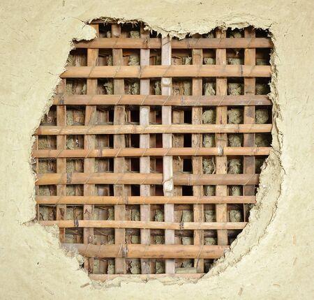 伝統: 竹スラットと泥から作られた伝統的な中国農家の家の壁 写真素材