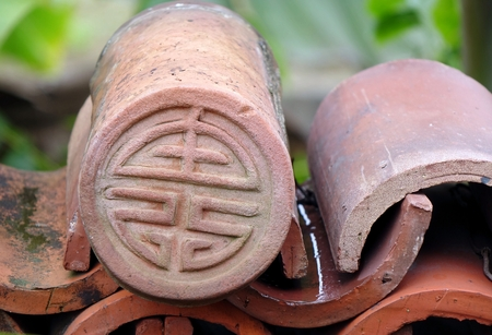 superstitions: Kiln fired Chinese eave tile end with long life symbol