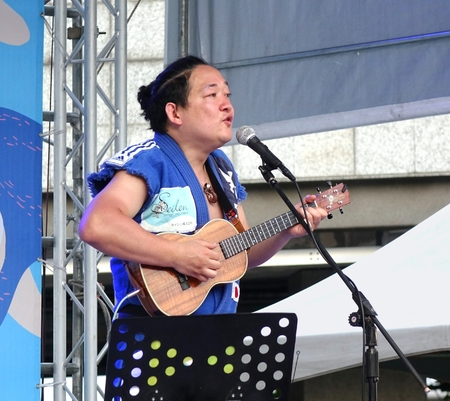 outdoor event: KAOHSIUNG, TAIWAN -- APRIL 23, 2016: Award-winning Japanese musician Yuta Uchiumi performs at the 1st Pacific Rim Ukulele Festival, a free outdoor event.