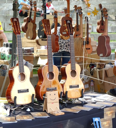 outdoor event: KAOHSIUNG, TAIWAN -- APRIL 23, 2016: Outdoor vendors sell musical string instruments at the 1st Pacific Rim Ukulele Festival, a free public outdoor event.