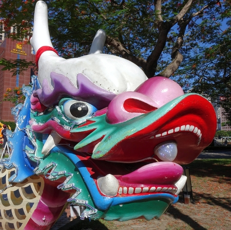 superstitions: KAOHSIUNG, TAIWAN -- MAY 27, 2016: The dragon shaped figurehead of a traditional dragon boat is being prepared for the upcoming Dragon Boat Festival. Editorial