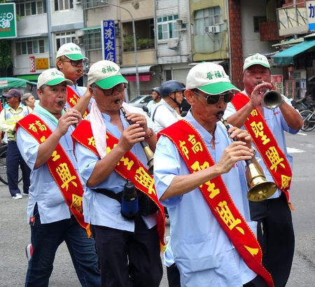 processions: KAOHSIUNG, TAIWAN -- JULY 9, 2016: Participants in a Daoist religious ceremony play the Suona, a traditional Chinese wind instrument. Editorial