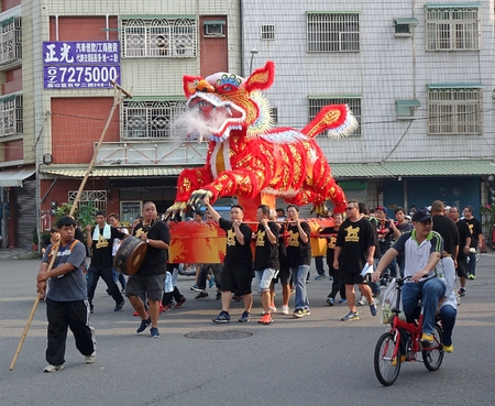 effigy: KAOHSIUNG, TAIWAN -- OCTOBER 15, 2016: The religious procession with the Fire Lion effigy is an integral feature of the yearly Wannian Folk Festival.