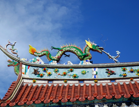 Chinese temple roof ridge decorated with mythological beasts