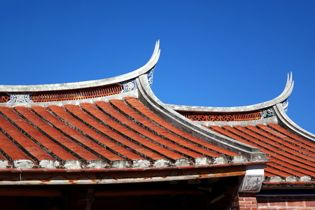 Traditional swallowtail roofs built in the Chinese Fujian style Stock Photo