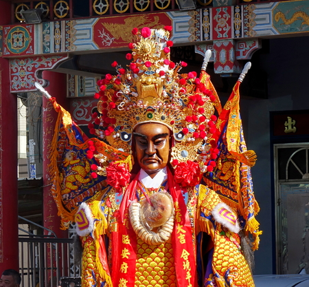 elaborate: KAOHSIUNG, TAIWAN -- JUNE 10 , 2017: Dancers wear large elaborate masks and costumes that make them extra tall to represent deities popular in Taiwans folk religion. Editorial