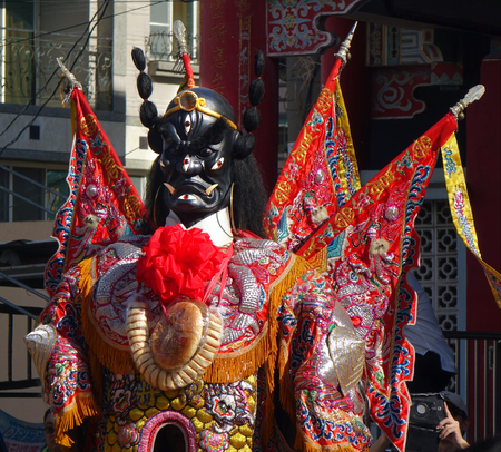 KAOHSIUNG, TAIWAN -- JUNE 10 , 2017: Dancers wear large elaborate masks and costumes that make them extra tall to represent deities popular in Taiwans folk religion. Editorial