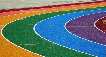 cushioned: Running tracks in several bright colors with white lane markings