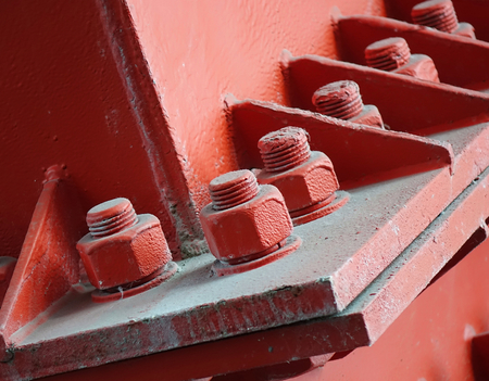 Heavy duty bolts and nuts hold a girder in place Imagens