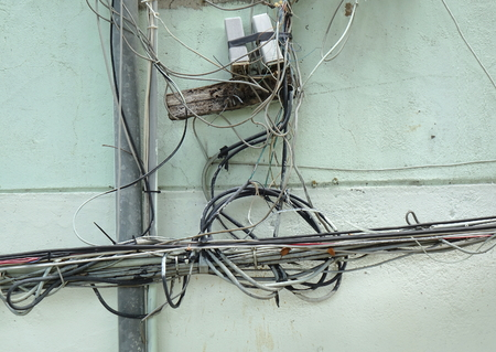 Careless electrical wiring poses a risk to health and safety Фото со стока - 109170129