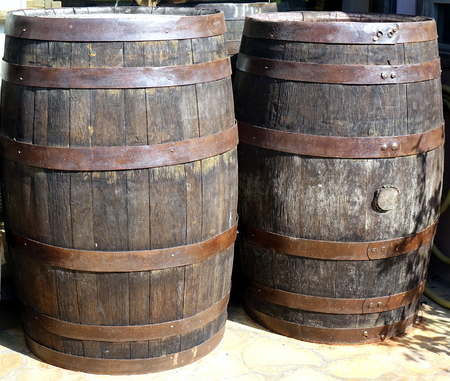 Vintage wooden oak barrels with rusting hoops