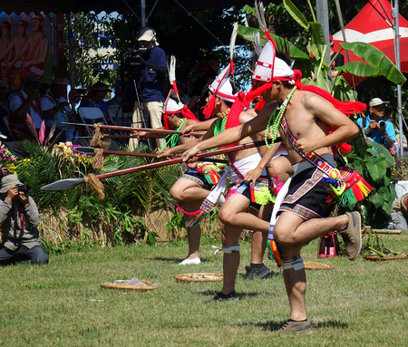 KAOHSIUNG, TAIWAN -- SEPTEMBER 29, 2018: Members of the indigenous Amis tribe in traditional costumes participate in the yearly harvest festival. Editorial