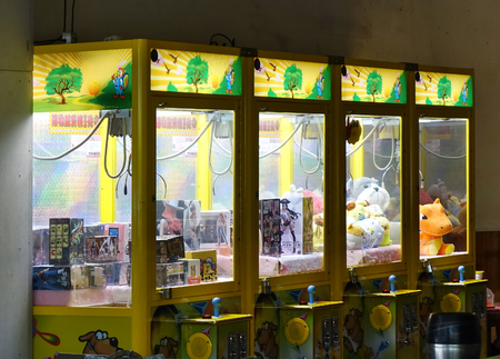 KAOHSIUNG, TAIWAN -- OCTOBER 19, 2018: Claw crane game machines have become the latest fad in Taiwan, occupying many empty store fronts. Sajtókép
