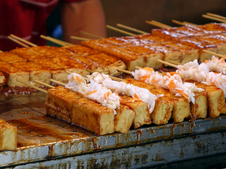 Stinky fermented tofu with pickled cabbage and hot sauce is popular in Taiwan Stock Photo