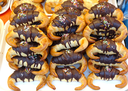 A market stall sells freshly baked Taiwan style croissants with chocolate