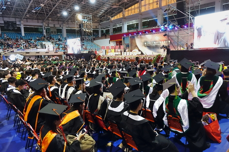 TAINAN, TAIWAN -- JUNE 2, 2018: Graduates listen to a speech at the annual graduation ceremony of NCKU university.