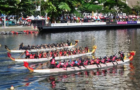 KAOHSIUNG, TAIWAN -- JUNE 7, 2019: Three teams compete in the Love River dragon boat races. Editorial