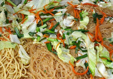 Chinese fried noodles with cabbage, chives and carrots