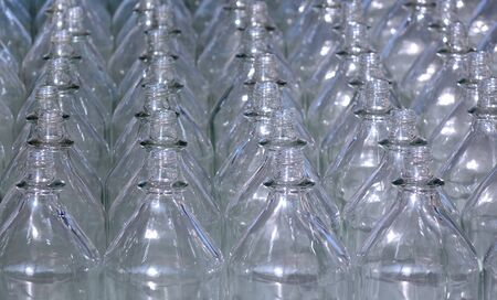 Rows of empty glass bottles with no caps